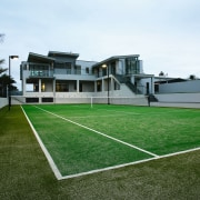 A view of some turf from TigerTurf. - artificial turf, ball game, estate, grass, house, lawn, leisure, leisure centre, plant, property, real estate, sport venue, sports, structure, white
