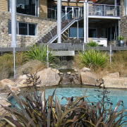 A view of some landsaping by Bridgeford Landscapes. landscape, landscaping, outdoor structure, pond, real estate, swimming pool, water, water feature, gray