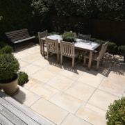 A view of some paving from Jagas Paving. backyard, courtyard, deck, floor, flooring, landscaping, outdoor structure, patio, property, walkway, yard, black, white