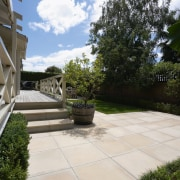 A view of some paving from Jagas Paving. backyard, courtyard, estate, home, house, outdoor structure, patio, property, real estate, walkway, yard, white, black