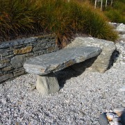 A view of some landscaping by LIANZ. - bedrock, boulder, landscape, outcrop, rock, rubble, stone wall, stream bed, walkway, wall, gray, brown
