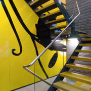 A view of  the Szencorp offices in angle, architecture, daylighting, handrail, line, stairs, yellow, orange, black