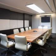 A view of  the Szencorp offices in ceiling, conference hall, furniture, interior design, office, table, gray, black