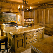 A view of this elegant kitchen featuring gold cabinetry, countertop, cuisine classique, home, interior design, kitchen, room, brown