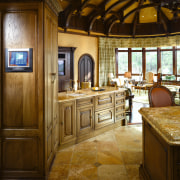 A view of this elegant kitchen featuring gold cabinetry, ceiling, countertop, cuisine classique, estate, floor, flooring, home, interior design, kitchen, room, brown