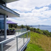 A view of a glass balustrade from Unex architecture, building, cloud, house, real estate, residential area, sky, white