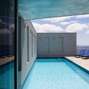 A view of a home by Creative Architecture. architecture, house, real estate, sky, swimming pool, water, teal, black