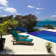 View of the pool and Outdoor entertaining area arecales, caribbean, estate, leisure, outdoor furniture, palm tree, property, real estate, resort, sea, sky, sunlounger, swimming pool, tropics, vacation, villa, blue