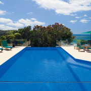 View of this Deep blue pool designed and bay, caribbean, estate, leisure, property, real estate, resort, resort town, sky, swimming pool, tourism, vacation, water, blue, teal