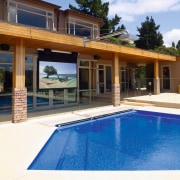 View of the pool, projector and screen for estate, home, house, leisure, property, real estate, resort, swimming pool, villa, window