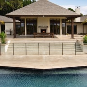 A view of some pavers by Peter Fell. deck, estate, facade, home, house, outdoor structure, swimming pool, villa,