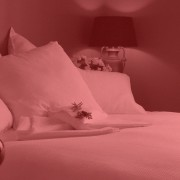 Country lodge painted in Resene shades bedroom with bed, bed sheet, bedding, bedroom, duvet cover, furniture, interior design, mattress, pillow, pink, product, red, room, suite, textile, red