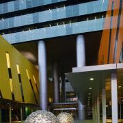 View of Brisbane square featuring bright colours, sculptured architecture, building, condominium, daylighting, daytime, facade, tourist attraction, black