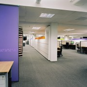 A view of the contemporary modern office space ceiling, floor, flooring, interior design, office, gray