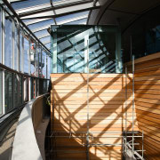 A view of the walkway featuring kaurio clad architecture, building, daylighting, facade, glass, handrail, line, stairs, structure, wood, black