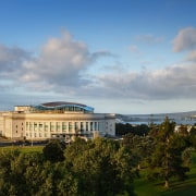 A view of the Auckalnd war memorial museum architecture, building, city, cloud, daytime, estate, home, horizon, landmark, meteorological phenomenon, real estate, sky, skyline, tree, gray, teal