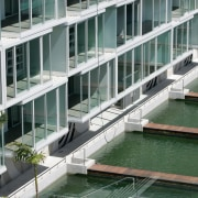 An exterior view of the lighter quay apartment architecture, building, condominium, facade, mixed use, water, gray