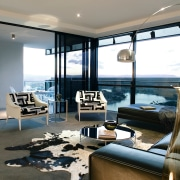 A view of the interior living spaces of interior design, living room, window, gray