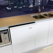 A view of this kitchen featuring the latest cabinetry, countertop, furniture, kitchen, product design, sink, gray, white