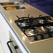 A view of this kitchen featuring the latest countertop, kitchen, kitchen stove, sink