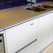 A view of this kitchen featuring the latest countertop, kitchen, major appliance, product, product design, sink, white