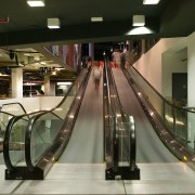 A view of the four moving escalator walkways escalator, brown, black