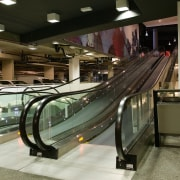 A view of the four moving escalator walkways escalator, glass, public transport, black