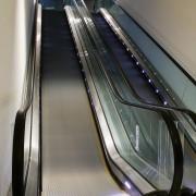 A view of the four moving escalator walkways escalator, gray, black