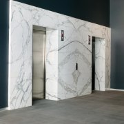 A view of the lobby and entrance to architecture, door, floor, glass, wall, gray, black