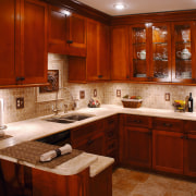 A view of this kitchen featuring solid maple cabinetry, countertop, cuisine classique, interior design, kitchen, room, under cabinet lighting, red