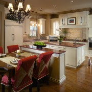 A view of this kitchen designed by Mcfarlane cabinetry, countertop, cuisine classique, dining room, floor, flooring, hardwood, interior design, kitchen, room, wood flooring, brown