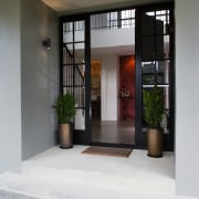 A view of some coloured concrete flooring from door, interior design, gray, white