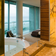 The spa bath, glass-panelled steam shower and custom architecture, bathroom, floor, flooring, interior design, room, suite, wall, window, brown, orange