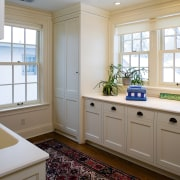 A view of this laundry featuring white timber bathroom, bathroom accessory, cabinetry, countertop, floor, home, interior design, kitchen, real estate, room, window, gray