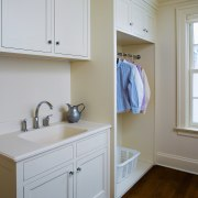 A view of this laundry featuring white timber bathroom, bathroom accessory, bathroom cabinet, cabinetry, countertop, floor, home, interior design, kitchen, laundry room, real estate, room, sink, wall, window, wood, gray