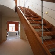 A view of cherry wood stairs complement a daylighting, floor, flooring, handrail, hardwood, laminate flooring, loft, property, real estate, stairs, wall, wood, wood flooring, wood stain, brown