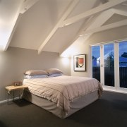 Buildng into the roof area provided enough space architecture, bed, bed frame, bedroom, ceiling, daylighting, estate, floor, home, interior design, mattress, real estate, room, wall, window, gray