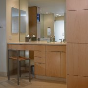 A view of  bathroom, wooden cabinetry, lights, cabinetry, countertop, floor, furniture, interior design, kitchen, brown