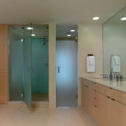 A view of a bathroom, tiled floor and bathroom, door, floor, glass, interior design, plumbing fixture, real estate, room, gray, brown
