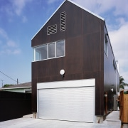 An exterior view of this house timbler cladding, architecture, building, facade, home, house, real estate, shed, gray