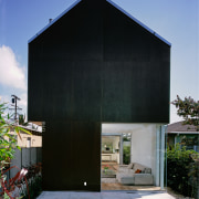 An exterior view of this house timbler cladding, architecture, building, facade, home, house, shed, siding, black