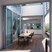 A view of  the outdoor entertainment area daylighting, door, glass, house, interior design, real estate, window, gray