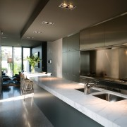 A view of this kitchen featuring polished concrete architecture, interior design, black, gray