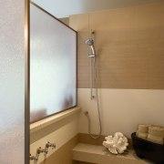 A view of a bathroom designed by Petersen bathroom, ceiling, floor, interior design, plumbing fixture, room, brown