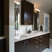 A view of a bathroom designed by Petersen bathroom, bathroom accessory, bathroom cabinet, cabinetry, countertop, interior design, kitchen, room, sink, black, gray