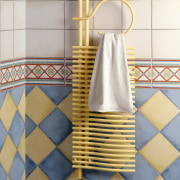A view of a heated towel rail from ceramic, floor, flooring, pattern, plumbing fixture, product design, tile, wall, yellow, white