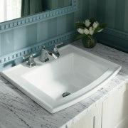 This Archer self-rimming basin features a Kohlewr Memoirs bathroom, bathroom sink, bathtub, ceramic, countertop, floor, plumbing fixture, sink, tap, tile, gray