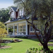 An exterior view of this traditional masonry home backyard, cottage, estate, facade, farmhouse, garden, grass, historic house, home, house, landscape, landscaping, lawn, mansion, outdoor structure, plant, plantation, property, real estate, residential area, siding, tree, yard