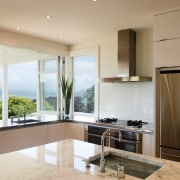 Carrara marble lends a classical element to the countertop, cuisine classique, interior design, kitchen, property, real estate, window, brown, gray