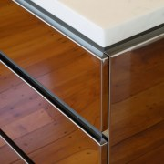So prefectly does the stainless steel island reflect angle, daylighting, furniture, plywood, product design, table, wood, wood stain, brown, white